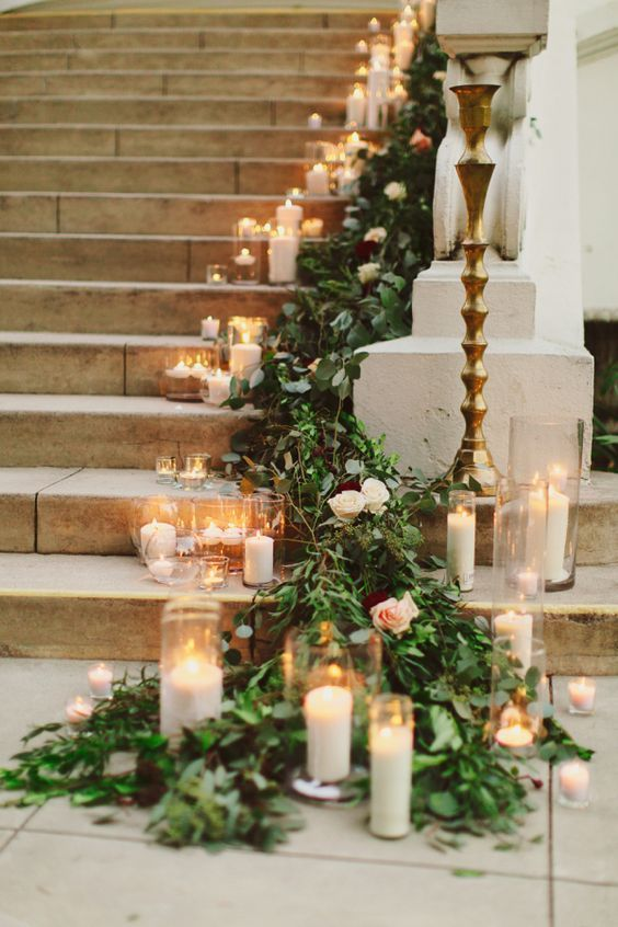 Wedding entrance decorated with candles and roses