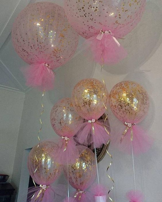 Table centerpieces with balloons and tutus