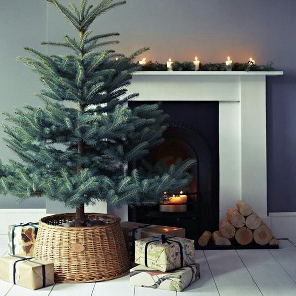 Minimalist Christmas tree in a wicker basket