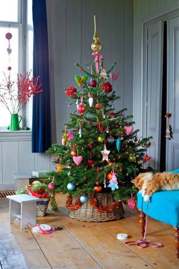 Christmas trees in baskets and decorations of many colors