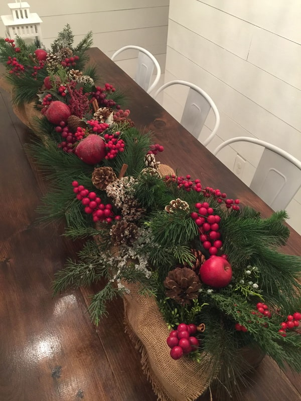 Christmas centerpiece with wooden box, pineapples and branches