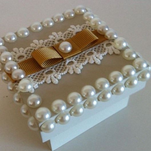 Pearls and bows help to make the MDF box look perfect