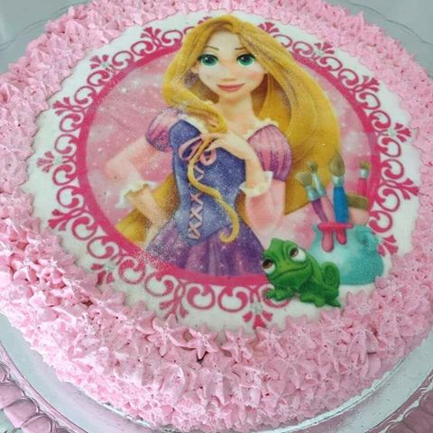 Princess Rapunzel cake with rice paper and pink whipped cream