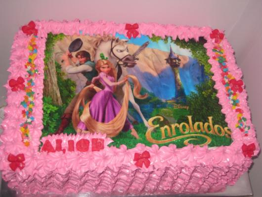 Rapunzel square cake with pink whipped cream