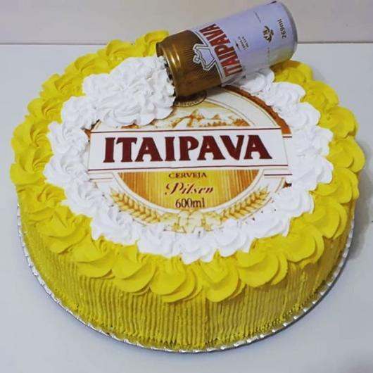 Beautiful round cake with rice paper and yellow and white whipped cream - the detail of the can on the top makes the cake even more beautiful and original!