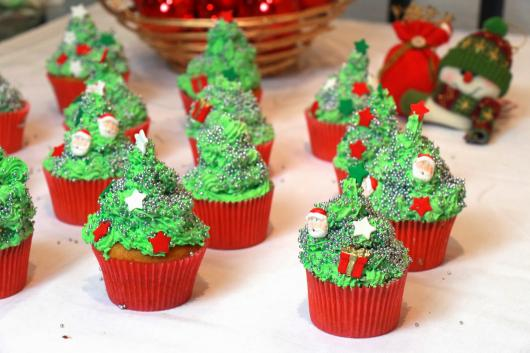 Christmas cupcake decorated with whipped cream tree