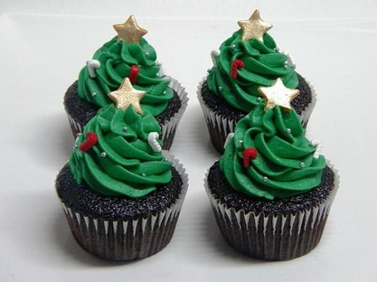 Christmas cupcake decorated with whipped cream and stars