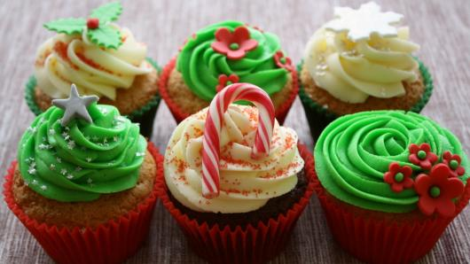 Christmas cupcake decorated with green and white whipped cream