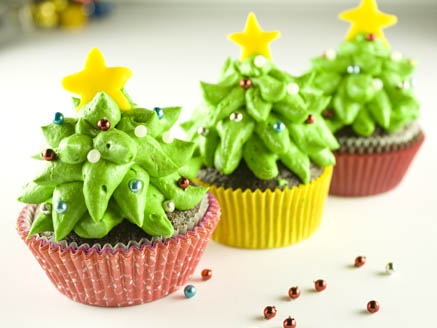 Christmas cupcake decorated with whipped cream tree and star confetti