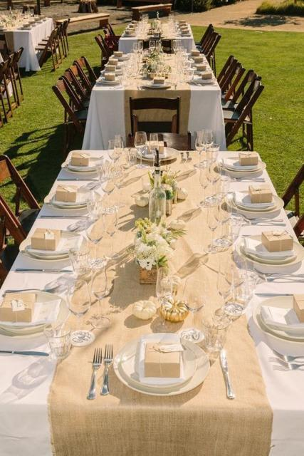 Outdoor table decorated in white and beige.