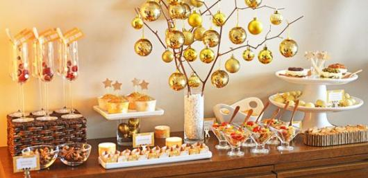 Food table decorated with golden balls.