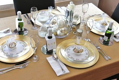 Dining table decorated with transparent plates and sideboards with clock design.