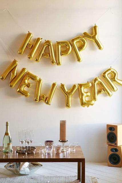 Decorated with balloons of golden letters forming the phrase: Happy New Year.