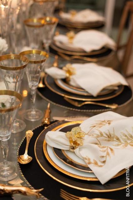 New Year's supper table with black and gold crockery.