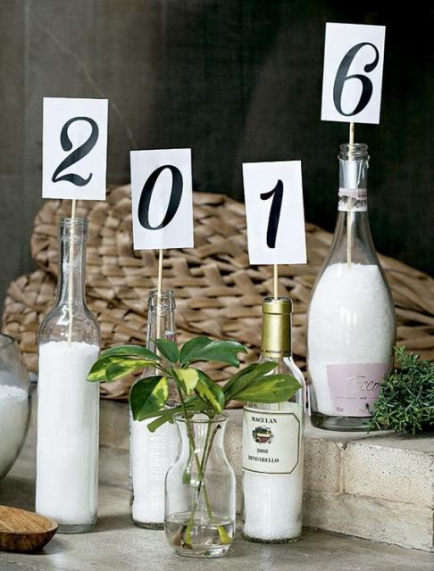 Bottles serving as vases, with little signs forming the new year.