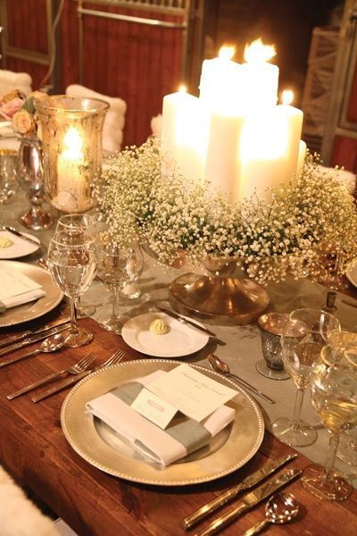 Table decorated with candle arrangement.