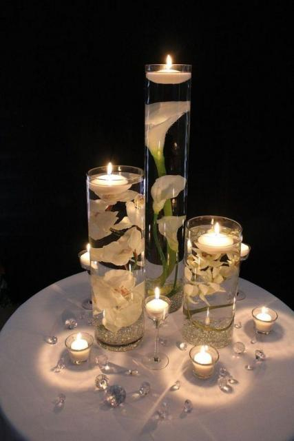 Decorate with flowers, glasses and candles.