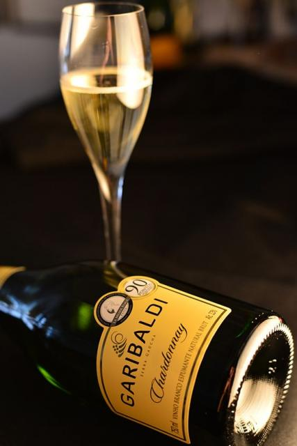 Glass of sparkling wine and a bottle of Garibaldi sparkling wine.