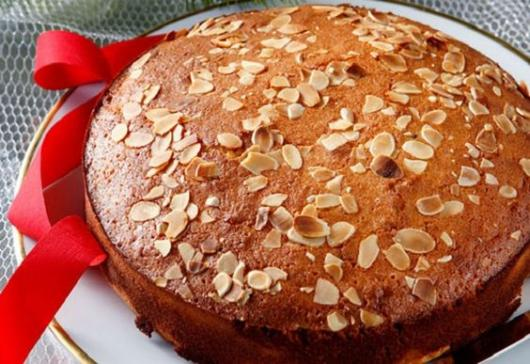Round cake with chestnuts on top.