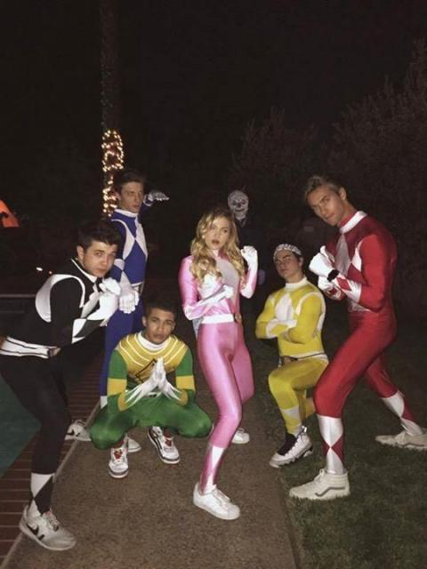 Group of friends dressed as Power Rangers, with Gigi Hadid in pink.