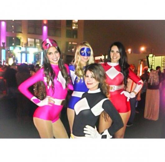 Four women dressed as Power Rangers.