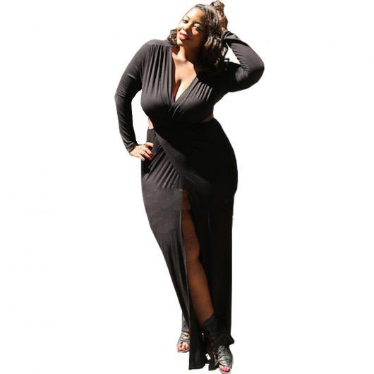 Model wears black dress with slit and v-neck.