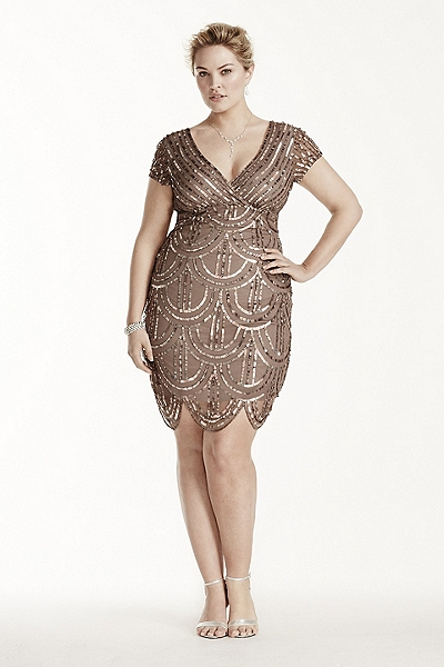 Model wears bright nude dress, short model with nude shoes and hair up.
