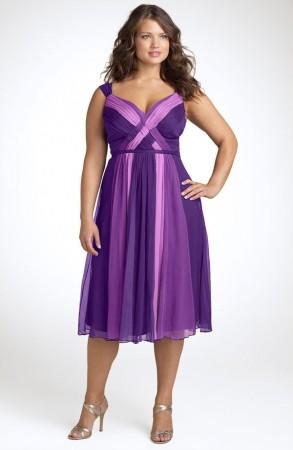 Model wears dark purple dress combined with silver sandals.