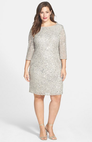 Model wears a gray half-sleeve dress with sparkles combined with nude shoes.