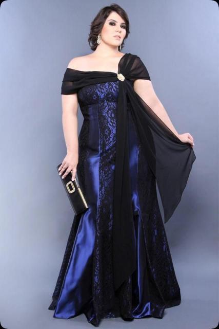 Model wears long, shoulder-to-shoulder, blue dress, mermaid train.