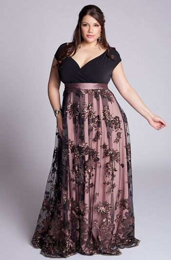 """Model wears long plus size dress in shades of black and rose with neckline """"V""""."""