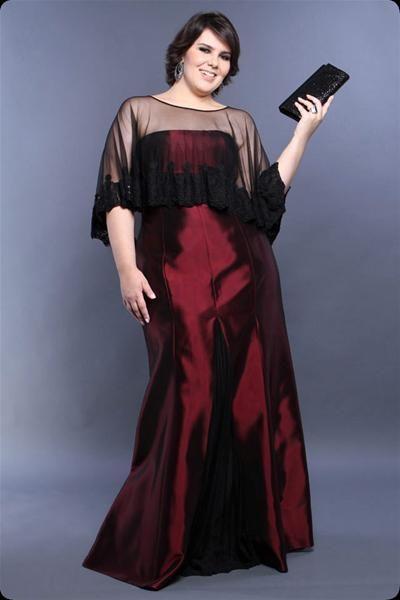 Model wears long burgundy satin dress.