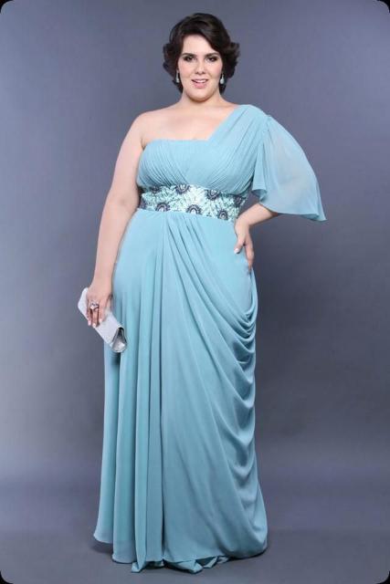 Model wears light blue one-shoulder dress, waistband with blue handbag.