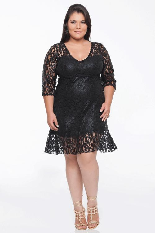 Model wears all black lace dress combined with caramel lace sandals.