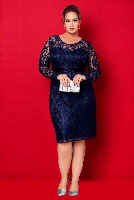 Model wears a medium length navy blue long sleeve dress, all in lace combined with sandals in the same color.