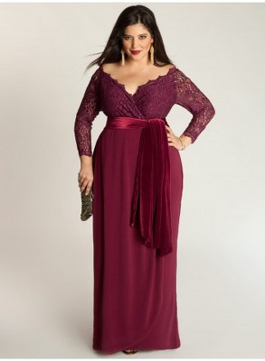 Model wears long burgundy dress with v-neck.