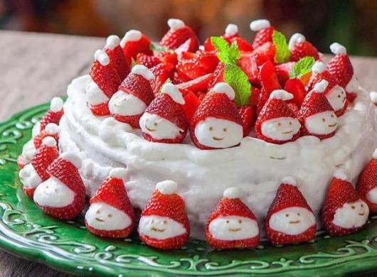 Simple white whipped Christmas cake with strawberries