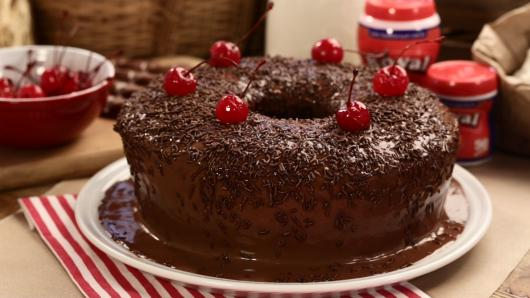 Simple Christmas cake decorated with cherry