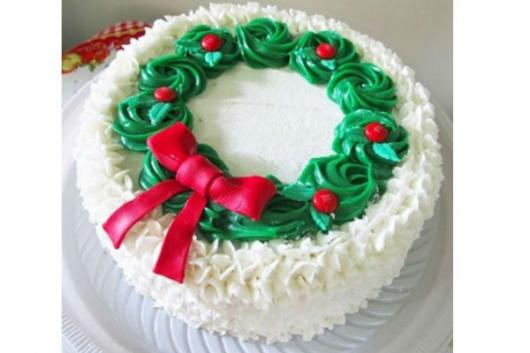 Simple white, red and green whipped cream Christmas cake