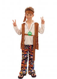 Boy in colored pants, white shirt and brown vest.