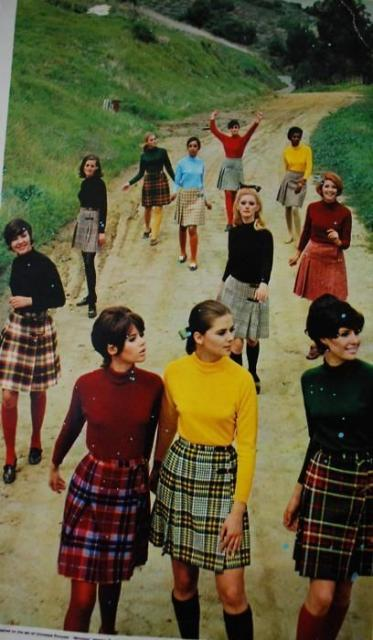 Women in plain plaid skirts and black and colored blouses.