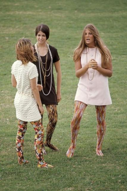 Women with printed dresses and pantyhose.