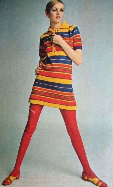 Twiggy in colorful striped dress and red tights.