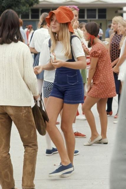Women in high school, in dresses, pants and bib.