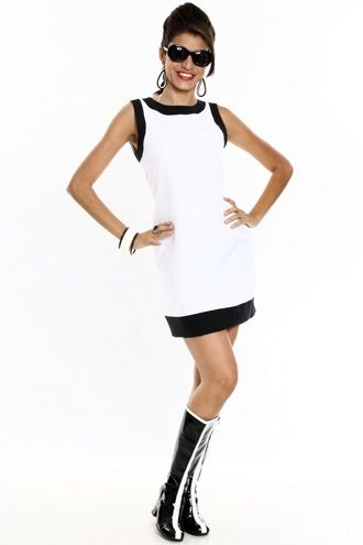 White structured dress with black edges.
