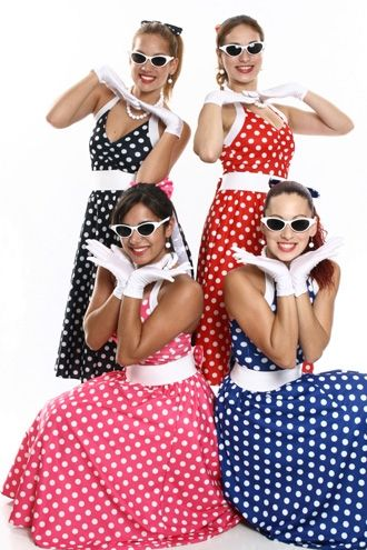 Women in black, red, pink and blue dresses with white polka dots.