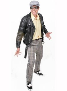 Man in checkered pants, yellow polo and black leather jacket.