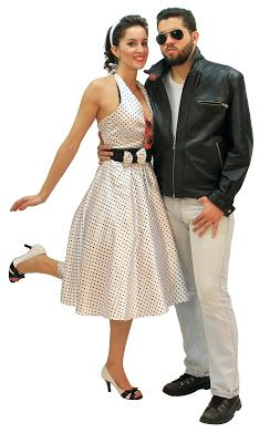 Sixties costumes for couples, with a woman in a polka-dot dress and a man in a black jacket.