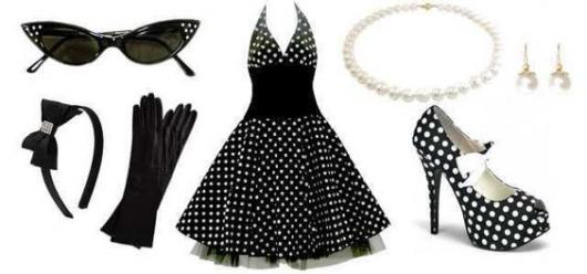 Set up with black polka dot dress, shoes with the same print, kitty glasses, pearls and gloves.