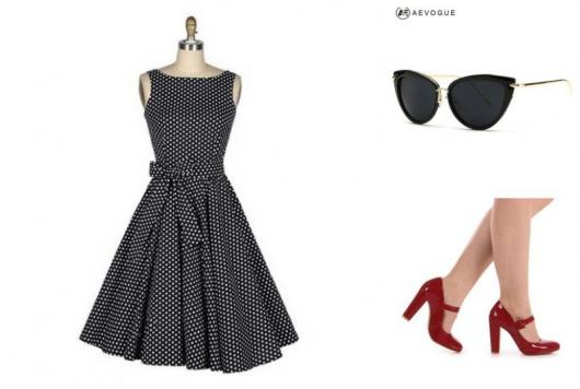 Fitting with polka dot dress, kitty glasses and red shoes.